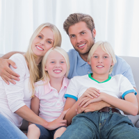 family-four-couch-smiling-sitting-boy-girl-123rF-26731509_xl.png